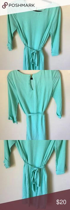 Everly Nordstroms -Tie Mini Lined Dress in Mint Everly Anthropologie Mini Lined Quarter Sleeve Tie Dress in Mint Size: Small Color: Mint Green Design: Tie Dress Neckline: Hi Neck Rounded Sleeves: 3/4 Sleeve Materials: Dress is 100% Polyester and the Lining is 100% Rayon  Measurements (approximate) Length: 34 inches Underarm to underarm (laying flat): 34 inches  Condition: Gently used, like new - No rips, tears or stains. ***** easily wrinkled material.. will need to be steamed upon…