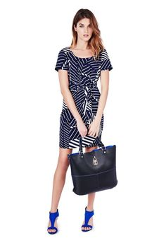 A wrap dress is a dress style that compliments all body types! This one has a nautical feel that is perfect for spring/summer  #justfabapparel