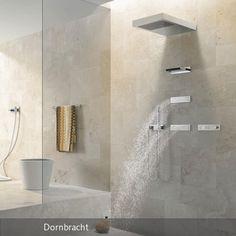 """Von Kopf bis Fuß entspannen klappt mit der Dusche """"Vertical Shower"""" von Dornbach. Das Duschsystem besteht aus mehreren Armaturen, die das Wasser gleichzeitig…"""