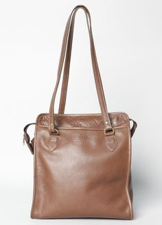 This Brooklyn Industries Montague Leather Zipper Top Tote comes in the classic leather brown and black, but also in turquoise, orange, and light blue--perfect for that spring time look!  100% genuine leather. 100% made in Brooklyn.