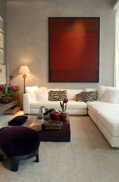 White sectional ~ Red art