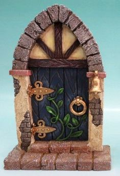 Features:  -Door color: Blue.  -Composition: Polyresin.  -Indoor and outdoor use.  Product Type: -Statue.  Color: -Multi-colored.  Style: -Contemporary.  Material: -Resin/Plastic.  Theme: -Fairy Garde #fairygardening