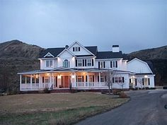 perfect country home...love this!   I'm a huge fan of the wrap around porch...dream home