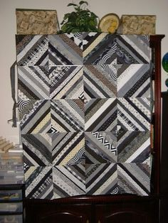 Black & White string quilt. Add gold and brown for the living room.