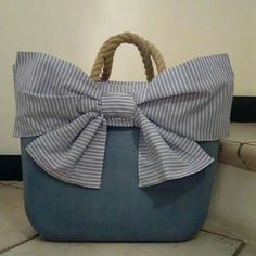 A fun summery type bag, with the big striped bow and the rope handle.