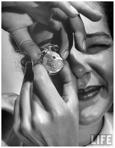 Photo Andreas Feininger Woman looking through micro camera 1949