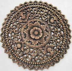 Round carved wall medallion