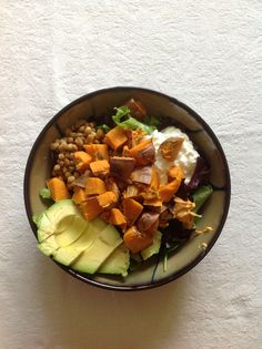 Lunch: salad with lentils, cottage cheese, roasted red pepper hummus, half an avocado, and half a baked sweet potato