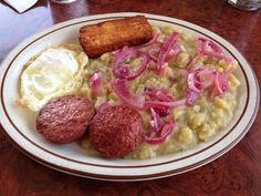 Breakfast is typically a light meal, often leftovers from previous nights' dinner. This is mangu and eggs which is common for breakfast.