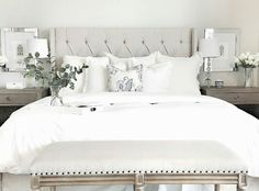 Duvet cover: Target.  Ruffled Euro shams: Anthropologie.  Small white fringe-edge pillows: Homegoods.  Headboard from wayfair