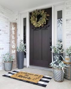 What a gorgeous front porch styled by – we are loving our Magnoli… - rustic farmhouse front door Farmhouse Front Porches, Door Decorations, Farmhouse Decor, House With Porch, Front Porch Decorating, Porch Styles, Entryway Decor, Home Decor, Front Door Decor