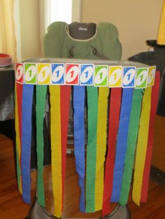 UNO themed first birthday party- highchair decor