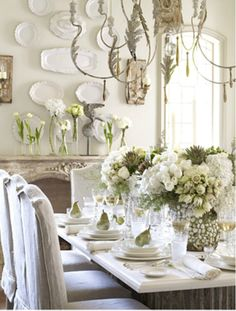 Floral Tablescape and I'm drooling over those white dishes on the wall....