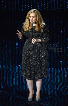 OSCARS 2013: Adele on stage at the Oscars in Burberry while singing Skyfall in a sparkling black Burberry dress and glittering Christian Louboutin heels.