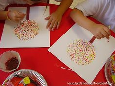 fall trees made with q-tip painting, or any kind of picture. I love this idea for the kids!!!