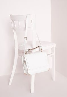 """Keep your day accessories chic with this metal trim should bag. In fresh white with gold finishes, this cute detailed bag will keep your style looking up to date and sleek.  Approx height 59cm/23"""" Approx width 23cm/9"""" Approx depth 14cm/..."""