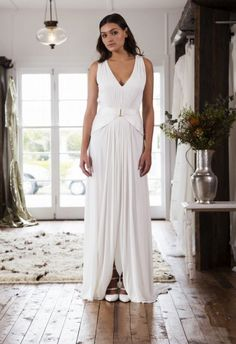This a-line floor length summer wedding dress with deep v neckline and silk Mikado hip detail. A subtle split up the front and the draping pleated chiffon skirt. Simple skirt with open v neckline on the back.