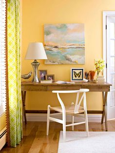 Simple, yet striking office space. In love with the wishbone chair! Check out more photos of this space: http://www.bhg.com/rooms/living-room/makeovers/orange-living-room/#page=3