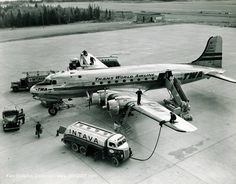 "Trans World Airlines (TWA) Douglas C-54E Skymaster (DC-4) NC45344 ""The Colosseum"" during a refuelling stop at Gander, circa early 1950s. From 1947, TWA operated a weekly freight run to Tel Aviv, via New York, Gander, Shannon, Paris, Geneva, Rome, Athens and Cairo. (Photo: Courtesy of the Ken Stoltzfus Collection)"