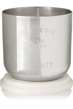"""The evocative scent of Tom Dixon's 'Royalty' candle is """"reminiscent of tea time with a pot of Earl Grey, scones, strawberry jam and the drive home in a '52 Bentley with tatty leather seats."""" Encased in a sleek hand-spun nickel vessel engraved with the label's logo, it has zesty top notes of Bergamot and Lemon, a heart of Verbena and Mint and a base of Cedar Wood. It comes with a marble lid that doubles as a stand, too."""