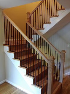 Stair railings with black wrought iron balusters and oak boxed type newel posts