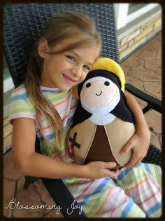 Blossoming Joy: Huggie Saint Dolls: Catholic Toys to Cuddle {Coupon Code!}