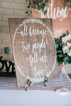 Such a sweet sign for the reception! | All Because Two People Fell in Love Wooden Sign | Rustic Wedding Signs | Reception Signs | Reception Decor | Rustic Wedding Ideas | Wedding Calligraphy | #receptiondecor #weddingsigns #rusticwedding