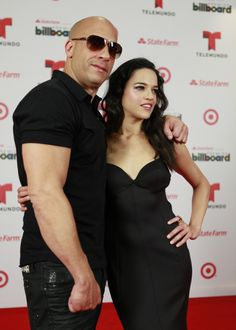Actor Vin Diesel, left, and actress Michelle Rodriguez, from The Fast and the Furious film franchise, pose at the Latin Billboard Awards in Coral Gables Thursday, April 25, 2013.
