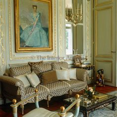 House of Windsor, Paris - A gilt-framed portrait of the Duchess of Windsor by her protege, Etienne Drian, is mounted on the painted panelling of the salon