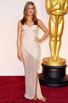Jennifer Aniston in a sparkly, mesh-like, nude Versace gown at the 2015 Oscars