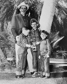 Original caption:The cowboy flavor is strong as Gregory Peck and his three sons gather for a family photo after a visit to the rodeo at Palm Springs. Daddy is clean shaven again after getting rid of the beard he grew for the film Moby Dick. Left to right, the cowboys are: Stephen, 8; Jonathan, 10; and Carey, 6. February 10, 1955