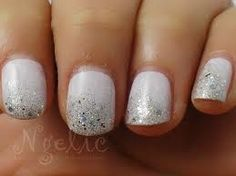Wedding manicure. White with sparkle of course :)