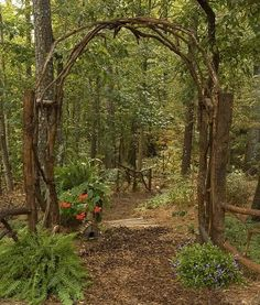 Arbor built with fallen trees...be still my heart!