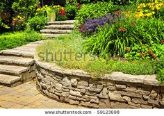 Google Image Result for http://image.shutterstock.com/display_pic_with_logo/56478/56478,1281936209,1/stock-photo-natural-stone-landscaping-in-home-garden-with-stairs-and-retaining-walls-59123698.jpg