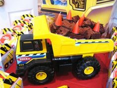 put chocolate cake in back of toy truck and sprinkle oreos on top for dirt look? candle on top