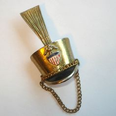 Vintage Drum Major Majorette Hat Brooch Stars and Stripes Military Insignia. $48.00, via Etsy.