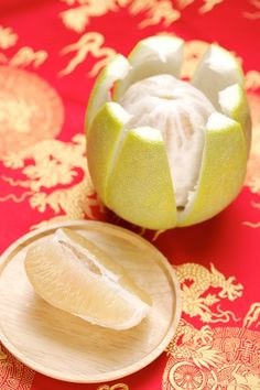 """The pomelo is a beloved fruit of the Mid-Autumn Festival. The word for pomelo in Chinese is homophonous with that for """"blessing"""", so pomelo is considered an auspicious fruit."""