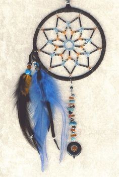 """In Native American culture, a dreamcatcher (Lakota: iháŋbla gmunka, Ojibwe: asabikeshiinh, the inanimate form of the word for """"spider"""" or Ojibwe: bawaajige nagwaagan meaning """"dream snare"""") is a handmade object based on a willow hoop, on which is woven a loose net or web. The dreamcatcher is then decorated with personal and sacred items such as feathers and beads. http://bit.ly/RBiMGh"""