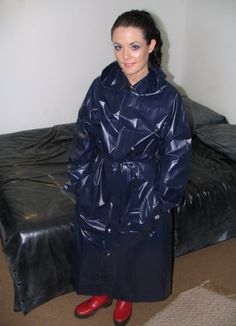 Adele in a navy pvc mackintosh