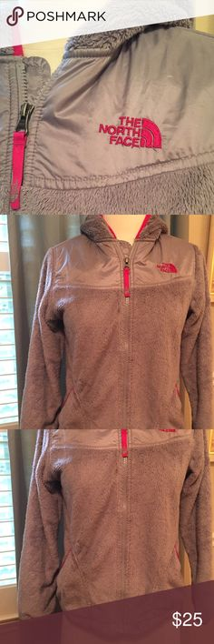 The North Face Girls Jacket Girls size L 14/16 Furry North Face Jacket.  Gray with pink trim.  Some signs wear include a little piling on the trim that does pull off and a pesky spot on the front of the jacket near the zipper.  It looks a bit more obvious in the photos than in person and if the nap of the fabric is brushed you can't see it at all.  This was my daughters coat but it fits me and I wear a women's XS. The North Face Jackets & Coats