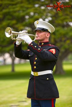 U.S. Marine plays Taps National Memorial Cemetery of the Pacific, Punchbowl