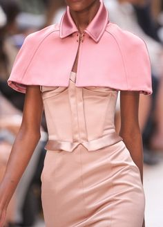 Seamed pink capelet with satin collar. Burberry Prorsum Spring 2013. Photo credit: Imaxtree.