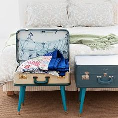 Vintage suitcases at the foot of the bed would make a GREAT way to store bedding.  The pop of color is pretty wonderful, too!