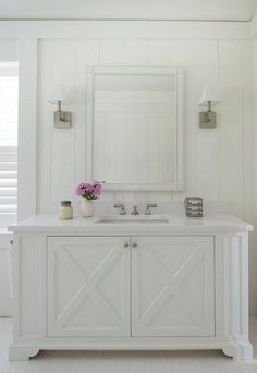 Custom cabinetry bathroom. All white bathroom. Bathroom milwork ideas. Bathroom wainscoting.