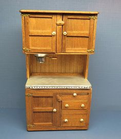 unknown artist, JD – oak Hoosier cabinet has a tin work surface, a tin flour bin and a built in sifter. Along with several cabinets and drawers (all working) it also has pull out cutting board. Made in 1979