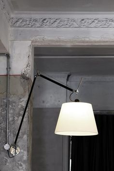 Tolomeo Mega Wall Light by Artemide. Such an elegant light. Love it connected to exposed electrical conduit as pictured.