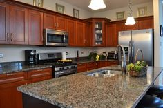 Cherry kitchen cabinets and granite counter-tops