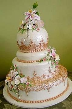 Absolutely stunning four tier wedding cake with so much intricate lace work detail. From Blare Solutions