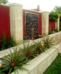 Outdoor Wall Water Features | Limestone planters, garden wall and water feature.