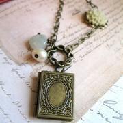 Pretty book shaped locket. I love non-traditional shaped lockets.